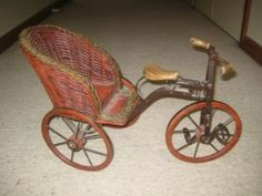 Vintage Tricycle with wicker seat.   // photo via web...