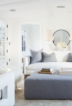 Soft gray and bright whites make for a soothing and stylish living room.