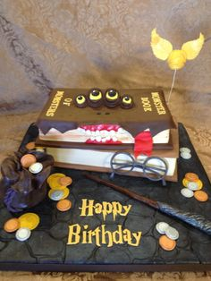 Harry Potter - Monster Book of Monsters - This cake was based upon several others - so thank you to the talented peeps before me! :) Everything is MMF - Cake was Sylvia Weinstock's Yellow - converted into Caramel Cake, with Caramel Simple Syrup and Chocolate Buttercream.