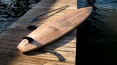 Bottom of the custom wood sup made by Jarvis Boards in Austin, TX