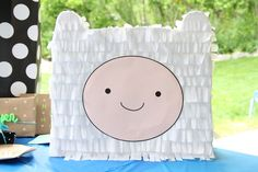 I have never seen the show Adventure Time, but my nephew loves it and when  he requested a Finn piñata for his birthday, you know I couldn't say no.  Challenge accepted! I think it turned out pretty great and it was so  rewarding to see his face light up when I showed it to him. Does a heart  good. It's kind of strange making a piñata you know you are going to smash  to bits. It gets me excited! You spend so much time on the construction  making it perfect, and a few minutes later it's a…