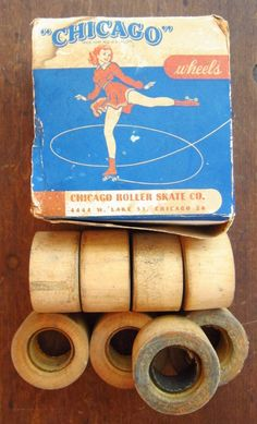 """Set of 8 wooden roller skate wheels in original box from the Chicago Roller Skate Company. Founded in 1905, it became the largest manufacturer in the roller skating industry through most of the 20th century. Among their many innovations was the patented """"Velvet Tread"""" wheel system, which included these wooden wheels, as stamped on the sides of the wheels."""