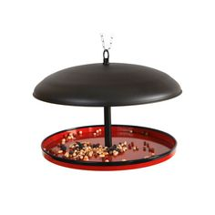 Elegant hemisphere-shaped bird feeder made of metal. It is easy to clean, refill and hang. Also,  its large capacity makes that it does not require frequent refilling.