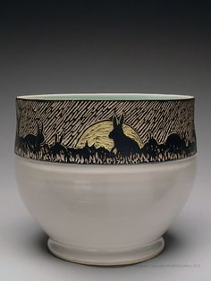 I like the strip of sgraffito; but maybe instead of white at the base an underglazed color