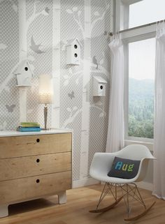 Customize your wall with 3-dimensional objects such as these simple white birdhouses hung on York's branch wallpaper.
