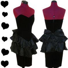 Black strapless 80s dress.