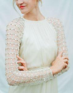 Embellished sleeves wedding dress.