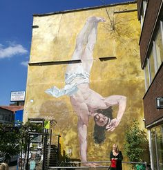 A classically trained fine artist Cosmo's work combines historical themes with an urban twist. Cosmo Sarson is best known for his giant mural of Breakdancing Jesus in Bristol. Situated opposite Banksy's 'Mild Mild West' piece it made international headlines when it was unveiled to the press.  #CosmoSarson #BreakdancingJesus #Bristol #ClassicalArt #StreetArt #Murals #Allpublicart