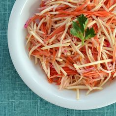 Root Vegetable Slaw With Orange-Cumin Dressing  Carrots, beets celery root or celeric.