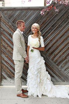 Stunning bride with a three quarter sleeve wedding dress!