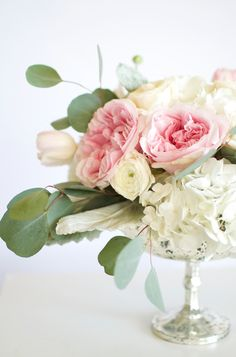 Lovely white and pink flowers arranged in a mercury glass pedestal bowl. | By Gavita Flora #pink #wedding #flowers