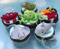 Under sea cupcakes stingray shark crab starfish octopus turtle Sea Turtle Cupcakes, Crab Cupcakes, Shark Cupcakes, Shark Cake, Kid Cupcakes, Animal Cupcakes, Turtle Cakes, Shark Birthday Cakes, Animal Birthday Cakes