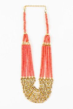 coral and gold necklace: