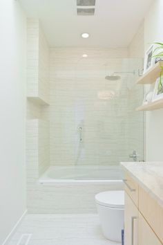 Glass wall for guest bathroom shower/bathtub combo.