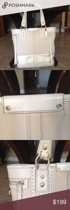 Coach Hamptons Limited Stripe Slim Tote Large tote by Coach. This came out in 2007 and retail was 498.00. It measures 16 by 14 by. Inside zipper compartment and key holder. Two zipper compartments on each side. It is canvas with leather accents and a satin ribbon. Gold hard wear. There is one small mark on satin ribbon as shown in pictures and one small area of slight discoloration as shown as well. Overall in great condition. Ask for more photos or info before buying if needed. I want you…