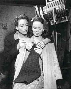 Joan Crawford teaching Ann Blyth to knit on Mildred Pierce