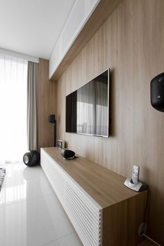 Inspiring Modern Apartment Interior Wooden Wall Accent With Mounted Tv Unit And Low Cabinet Console.