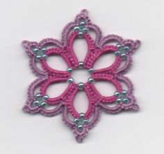 I get side-tracked easily... but that's what I love about tatting!  There seems to be an endless source of inspiration at our fingertips.  S...