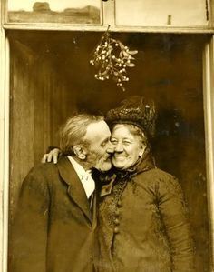 A delightful vintage photo (circa late 1800's/ early 1900) of an older couple kissing beneath the mistletoe. ........      (via Skye)