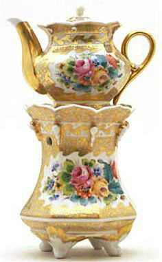 Teapot #421  Octagonal stand on four white feet, highly colorful, mostly crackle gold with floral decorations in   one panel on stand and two panels on pot; gold and white teardrops hang from top of stand   below scalloped collar.  Acquired in Nancy, France