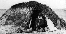 A photograph in Dr Memmot's book shows an Aboriginal man sitting in the doorway of a dome-shaped building