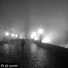 Charles bridge Prague with @ppsk92  Karlův most #charlesbridge #bridge #czechrepublic #europe #cz #eu #architecture #archilovers #architecturelovers #architectureporn #lights #bw #black #white #blackandwhite #fog #winter #human #man #person #siluet #melancholy #instadaily #igers #igerscz