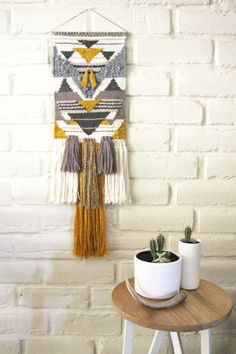 Golden tassel handwoven wall hanging tapestry by CopperCollective