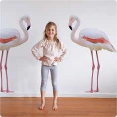 These 2 real0life photogrpahs of flamingo's stand guard in a living space or child's bedroom for a bit of fun and colour!  CONTENTS:  2 flamingo's, mirroring images  SIZE:  123cm high x 72cm wide each  OPTIONS:  Select to have the flamingo's facing eachother or facing to the left or right  APPLICATION:  This design is simple and easy to install, simply peel from the backing and stick to the wall