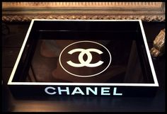 """CHANEL, Black Lacquer Serving Tray, White Replica Chanel Logo 14"""" x 18"""" These gorgeous trays make a HUGE statement at a small price-point. These are not authentic Chanel trays. They are replica """"Chanel Inspired"""" trays made by me. Black Lacquered Wood Serving Tray with hand-painted white rim and matching White Vinyl Replica CHANEL logos. MEDIUM 14"""" x 18"""" REPLICA CHANEL SERVING TRAY* $175"""