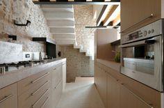 Kitchen / natural wood / stone by Studio bassot