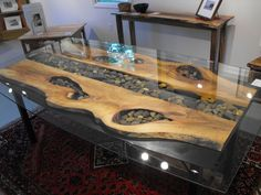 So cool- wood steel and pebble table!!
