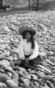 Westward Ho!, Girl On Pebble Ridge 1906. From The Francis Frith Collection, a privately-owned archive of over 130,000 photographs of Britain from 1860-1970 that you can browse online for free anytime. #francisfrith #photography #nostalgia