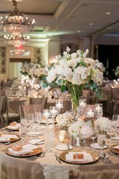 Large textured and gardeny centerpiece; using hydrangea, tulips, garden roses, peonies and flat eucalyptus.