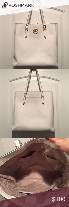 White Michael Kors bag! Used a couple times and is authentic and purchased in LA. Kept in good condition just a little bit dirty on the bag but as you can see from the picture it's barely noticeable. I absolutely love this bag. Please be sure, no returns Michael Kors Bags Shoulder Bags