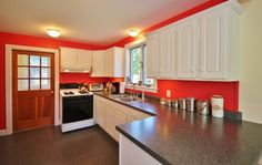 We love this splash of color in Harbor House's kitchen, located in Cushing, Maine.
