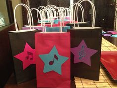 Rock star birthday goody bags. used cardstock stars and musical stickers