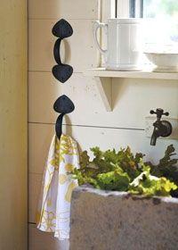 old drawer pull = towel holder (for kitchen towels)