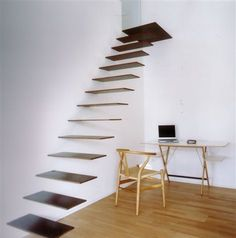 Floating staircase with black glass treads    The Design Inspiration