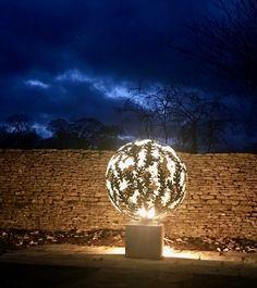 Lit up at night the Oak leaf design Brass sphere sculpture David Murphy, Hydrangea Flower, Flowers, Aspen Leaf, Garden Sculptures, Steel Sculpture, Oak Leaves, Leaf Design, Solid Brass