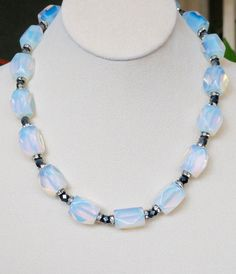 A personal favorite from my Etsy shop https://www.etsy.com/listing/268992450/opalite-necklace-with-czech-crystals-and