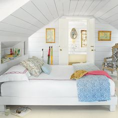 And in the upstairs bedroom, built-in shelving provides storage, maximizing the available space under the low, pitched roof.