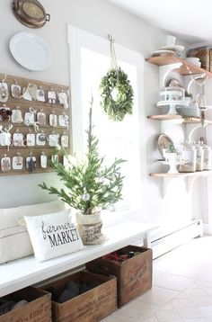 Neutral Farmhouse Holiday Inspiration A bench with crates underneath in the entry.
