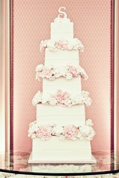 Romantic, white wedding cake with pink and white flowers and S monogram topper! This wedding cake is perfect! <3