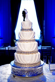 simple, elegant wedding cake! love the pleating