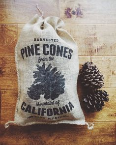 Pinecones harvested from the Mountains of California in a printed burlap bag with optional cinnamon scent