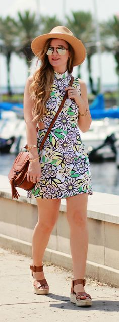 Floral cut out summer dress styled with a tassel crossbody bag, flatform espadrilles, and mirrored sunglasses. Perfect summer outfit!