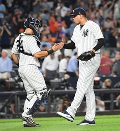 New York Yankees catcher Gary Sanchez and New York Yankees relief pitcher Dellin Betances celebrate their win against the New York Mets in a MLB baseball game at Yankee Stadium on Monday, Aug. Baseball Game Outfits, Baseball Games, Baseball Players, Damn Yankees, New York Yankees Baseball, Yankees Baby, Subway Series, Gary Sanchez, Softball Shirts