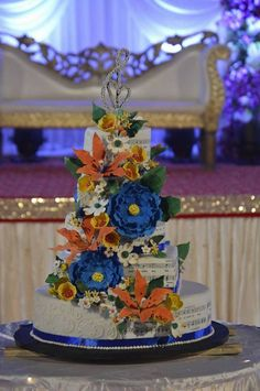 A musical themed wedding cake with sugar paste flowers.