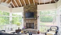 screen porch with fireplace and flatscreen tv