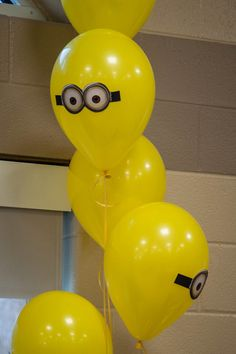 yellow balloons with taped minion faces